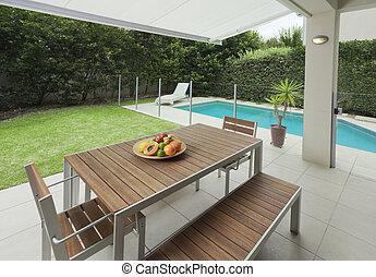 Modern backyard - Modern suburban backyard with table ...