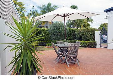 Modern backyard with table