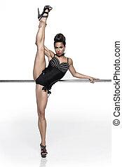modern ballet dancer dancing on the white studio background