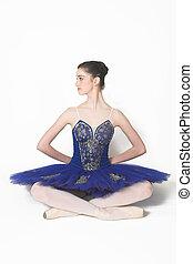 Profile of a Ballerina wearing a blue tutu sitting down
