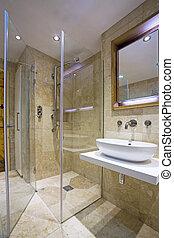 contemporary Luxury Bathroom with travertine tiles.