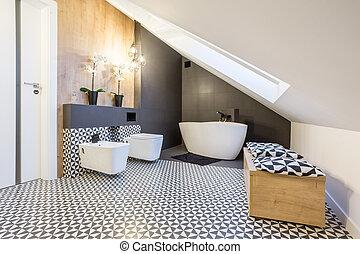 Modern bathroom interior at the attic