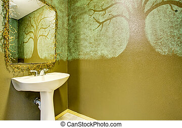 Modern bathroom interior with art painted green walls