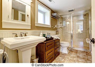 Modern bathroom interior with glass door shower