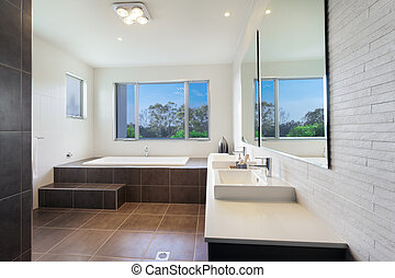 Modern bathroom - Modern twin bathroom with stylish bath