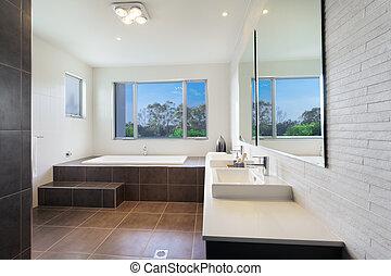 Modern bathroom - Modern twin bathroom with stylish bath