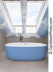 Modern bathroom with blue bathtub