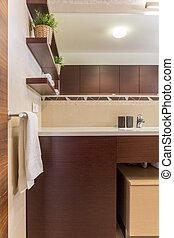 Modern bathroom with brown furniture