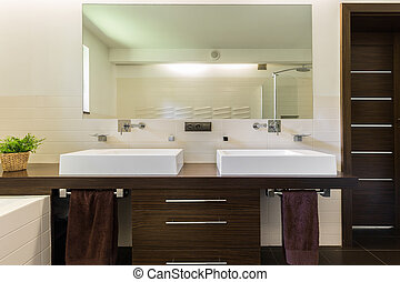 Modern bathroom with dark furniture - Modern bathroom with ...