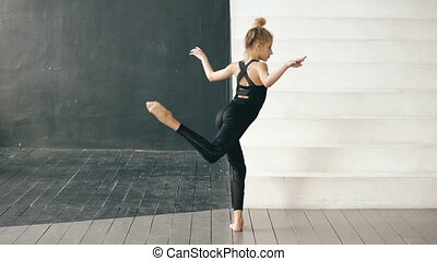 Modern beautiful teenage girl dancer perfomance contemporary dance in ballroom indoors