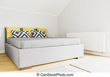Modern bedroom in attic