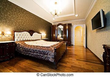 modern bedroom - Beautiful wide bed in a modern bedroom