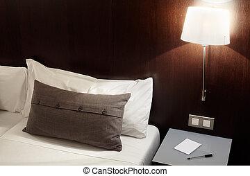 Modern bedroom, pillow at night