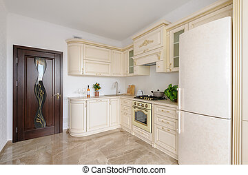 Modern beige colored luxury kitchen
