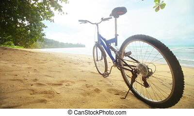Modern bicycle on a tropical the beach without people