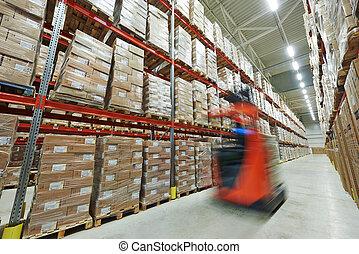 modern big warehouse - long stack arrangement of goods in a...