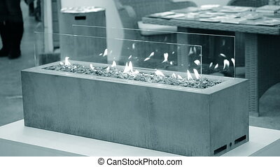 Modern bio fireplot fireplace on ethanol gas. Smart ecological alternative technologies. Contemporary biofuel on ethanol close-up. Energy saving innovation. Blue gray color