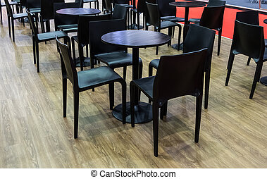 Modern black chair and circle wooden table set.