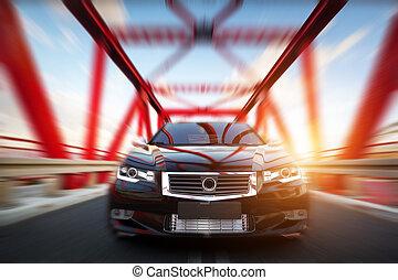 Modern black metallic sedan car on the bridge road. Generic...