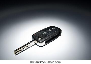 car key on dark background
