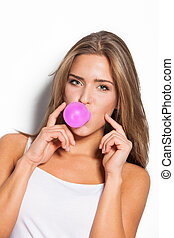 chewing gum bubble - modern blonde girl with pink chewing...