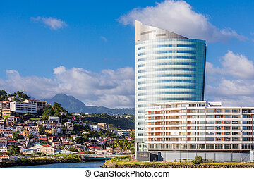 Modern curved high rise hotel resort on the coast of Martinique in the Caribbean