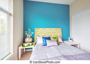Modern blue bedroom interior.