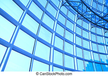 modern blue glass wall of office building