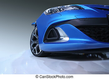 sports car - modern blue sports car in showroom