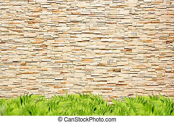 Modern brick wall and green grass