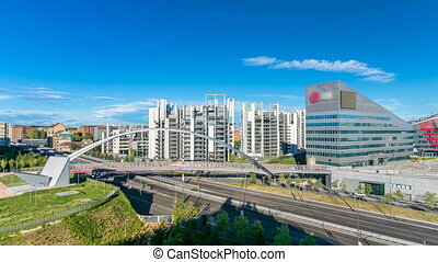 Modern bridge and buildings in the new area of Portello timelapse, Milan, Italy