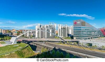 Modern bridge and buildings in the new area of Portello...