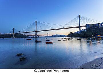 Modern bridge at sunset