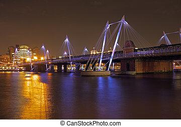 Modern bridge in London UK at night