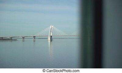 Modern bridge over bay in sunny day