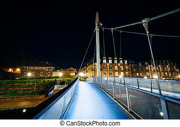 Modern bridge over Carroll Creek at night, at Carroll Creek Linear Park, in Frederick, Maryland.