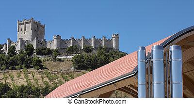 Modern building against old spanish castle
