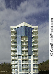Modern building against vibrant blue sky with clouds