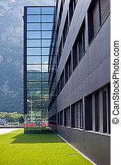 Modern building among mountains