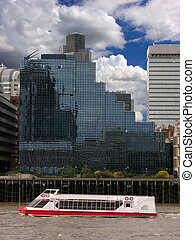 modern building and passenger ship on the river