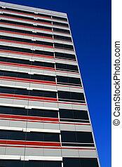 Close up of a modern building over blue sky.