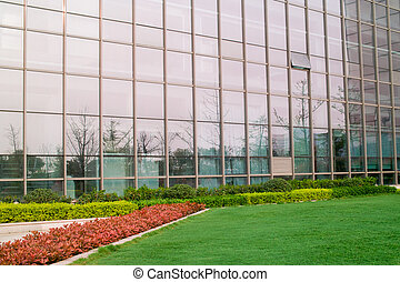 Modern building exterior with garden in front of it