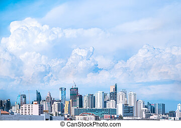 modern building in city and big blue cloudy sky background