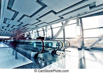Modern building interior with escalator - Modern building ...