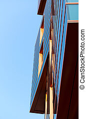 Modern building mirror facade in blue tone
