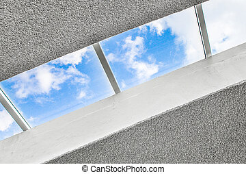 skylight - Modern building skylight with blue sky and clouds