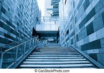 modern building stairway - staircase between the modern...