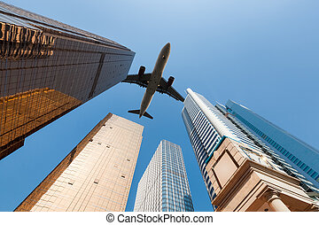 modern building underneath airplane , abstract cityscape in...