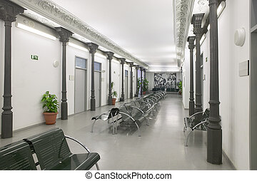 Modern building waiting room with metallic chairs