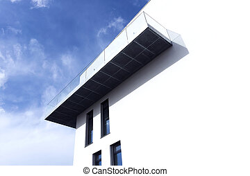 modern building with a balcony on a sunny day